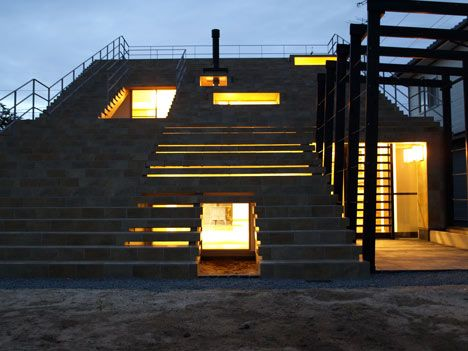 """Click through for a story and two dozen or so photos of this """"Stairs-House by y+M Design Office."""" From the outside, it looks a bit like bleachers, but inside, it's not at all. It also has a covet-worthy wall of bookshelves [http://pinterest.com/pin/175218241725011396/ ]."""