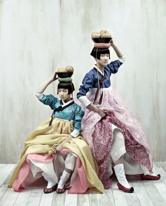 """During the National traditional festivities called 'Chuseok', many Korean people used to wear the hanbok. I wanted to show this typical ambiance with both a lyric and modern touch. I wanted a neutral stage; only shadows and reflections mattered to me: Colours, faces and models were enhanced by cold and light tones creating an almost surreal feeling."""