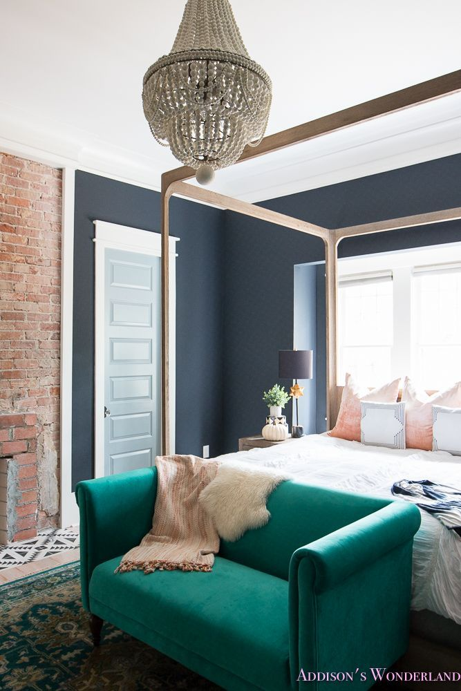 Fresh Ideas for Fall Home Tour! - Addison's Wonderland Tour our historic vintage chic bedroom restoration featuring black walls, white beaded chandelier, red brick fireplace, whitewashed Shaw hardwood flooring, four poster bed and emerald green rug and loveseat.