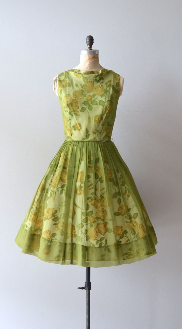 vintage late 1950s, early 1960s apple green silk chiffon dress with yellow floral under layer, fitted waist, full skirt and metal back zipper.