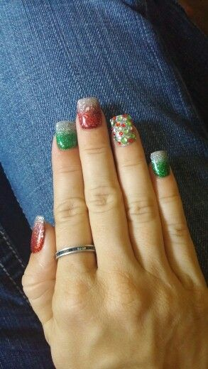 Christmas color fun! Green and red glitter powder with silver. Silver accent nail with red, green and clear rhinestones.
