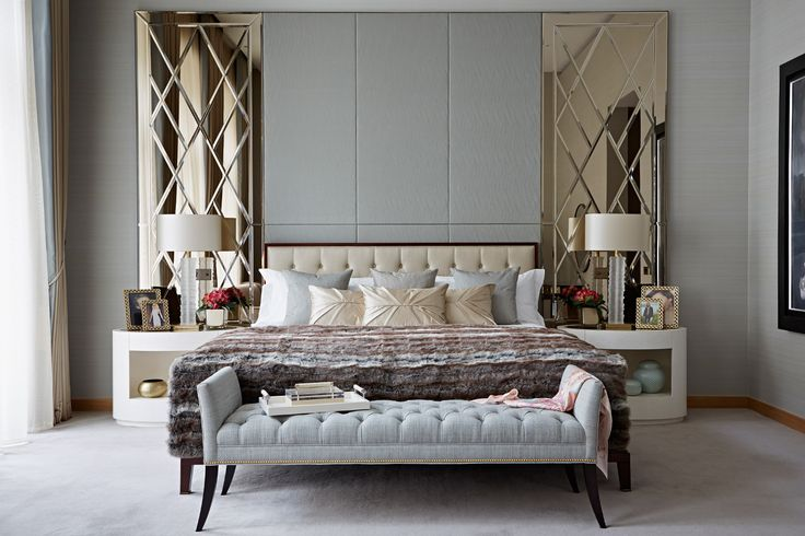 A glamorous master bedroom in a lateral apartment in London's One Kensington Gardens development. The master bedroom features a seating area with television and dressing area || Taylor Howes