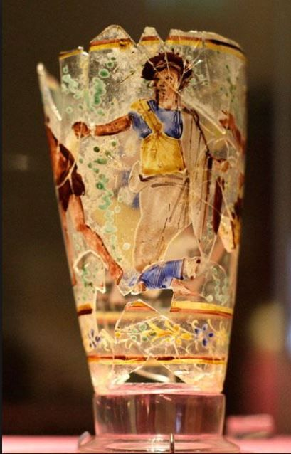 Roman glass painted goblet, 1st century A.D. Afghanistan, Begram, the main figure is the goddes Isis and this glassware was probably imported from Alexandria, 13.5 cm high. National museum of Afghanistan, Kabul