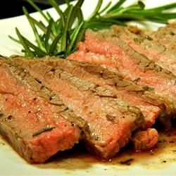"Tuscan Flank Steak | ""Flavorful flank steak is marinated for several hours in a marinade of lemon zest, olive oil, rosemary, and garlic, then grilled to perfection."""
