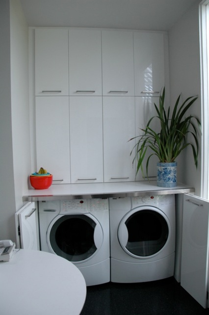 "Look how clean!! My ""laundry room"" is in our detached garage where the washer and dryer serve as cat beds."