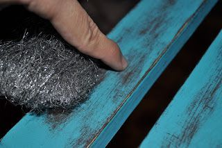 Distressing furniture.  Using fine steel wool helps to distress paint but does not leave lines like sandpaper.