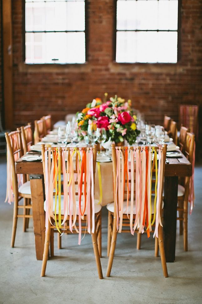 Accent your wedding chairs with streamers and ribbons.