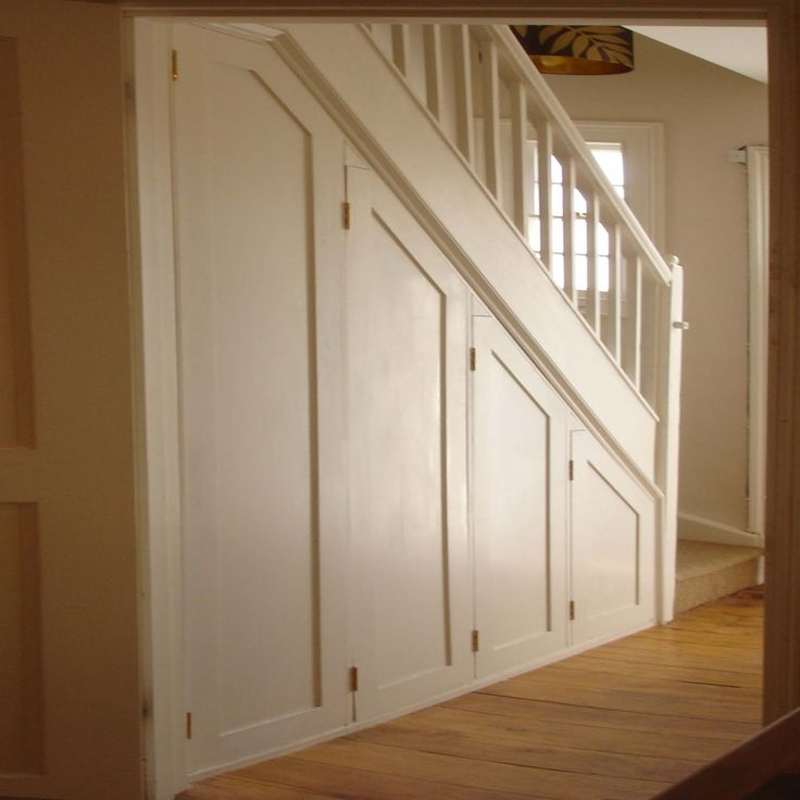 Interior , Cupboard Under The Stairs Maximize The Empty Space in Beautiful Way : Cupboard With Many Doors For Extra Storage Idea Under Stairs