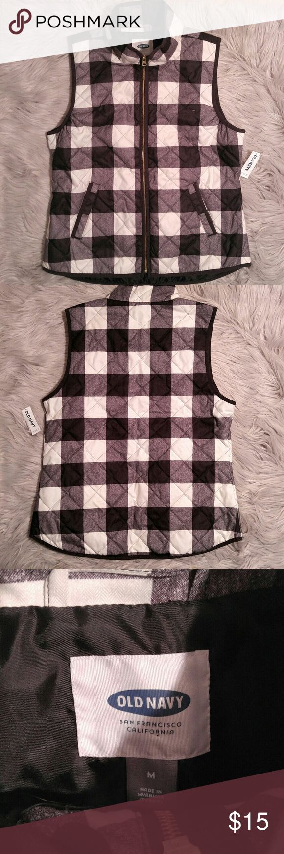 Old Navy plaid black and white vest bnwt Old Navy plaid black and white vest bnwt Size M Poly lined Fleece like outer Old Navy Jackets & Coats Vests