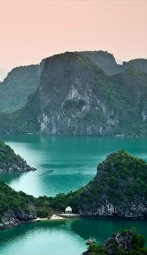 H? Long Bay, in northeast Vietnam, is known for its emerald waters and thousands of towering limestone islands topped by rainforests. (Top Design)
