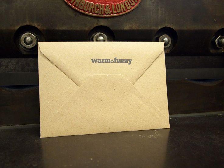 Logo'd envelope for design agency Warm & Fuzzy. single colour on 100% recycled kraft envelope.