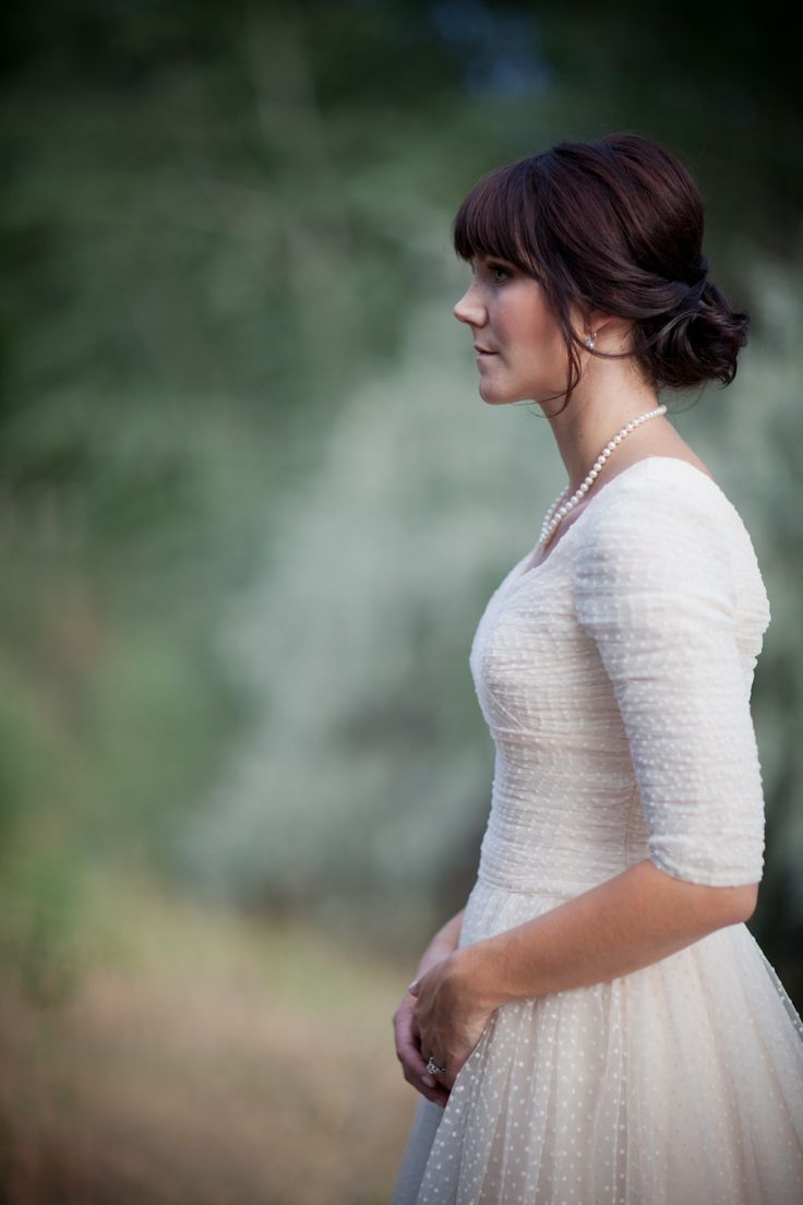 gorgeous dotted swiss wedding dress. love the sleeve length.