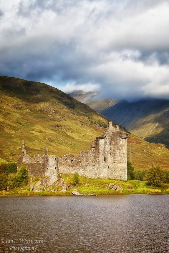Kilchurn Castle Ruins in the Highlands of Scotland, looking across Loch Awe.