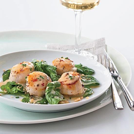 "Seared Scallops with Pinot Gris Butter Sauce | Hugh Acheson (an F&W Best New Chef 2002) flavors shallots with butter and Pinot Gris to create a sauce for scallops: ""Pinot Gris loves shellfish,"" he says."
