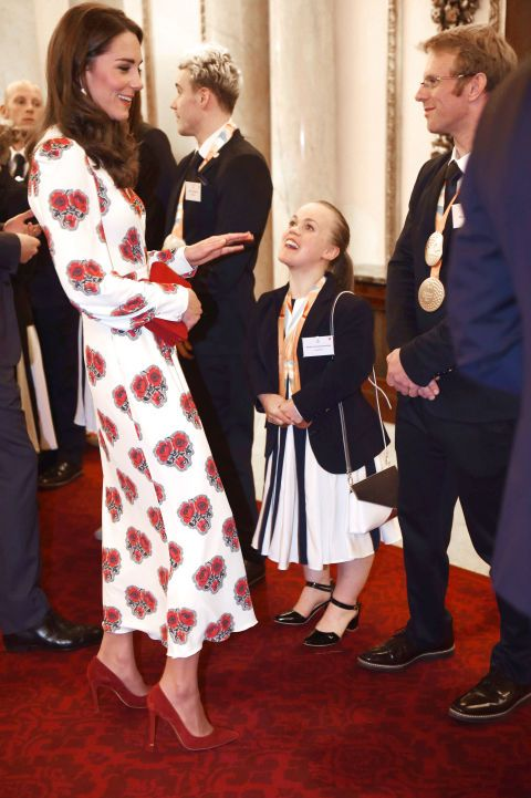 Kate wore a red floral dress by Alexander McQueen to a reception honoring the members of Great Britain's 2016 Olympic team. She carried a red clutch that coordinated with her red heels.