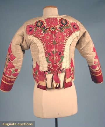 "Hungarian ""kodmen"" Jacket, from Komitat Bekes, short, fitted w/ long sleeves, white leather w/ shearling lining, red leather cuffs & front placket, multi-color wool pom-pom buttons, rose & red leather floral appliques w/ colorful wool embroidery, 19th c"
