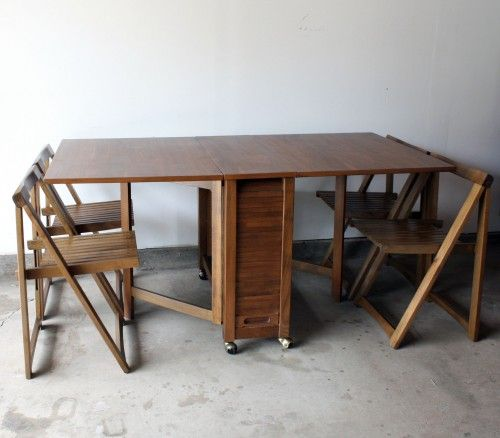 romainian table, hidden folding chairs | with tambour door table which stores four folding slat design chairs ...