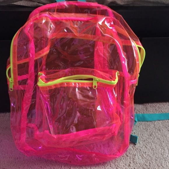 Pink see through American Apparel back pack I brought it from the American Apparel Outlet in Soho, Manhattan. It has one large compartment and one small from compartment. The straps are solid pink and green at the ends. It can hold laptops and school books. I used it once for the first day of school. American Apparel Bags Backpacks
