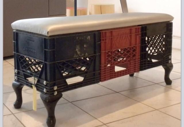 milk crates, old chair legs and a padded top seat make for pretty elegant bench