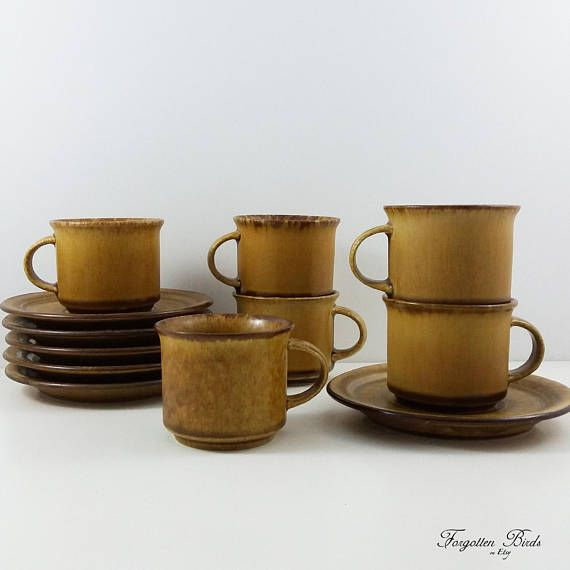 Six vintage scandinavian coffee cups and saucers (12 pieces: 6 cups and 6 saucers), part of the Sierra dinnerware set.  Product´s material: Stoneware, semi matte glaze Color: Drip glaze in browns Motif: Coffee cup and saucer, pattern Sierra Company: Höganäs Keramik Country: Sweden