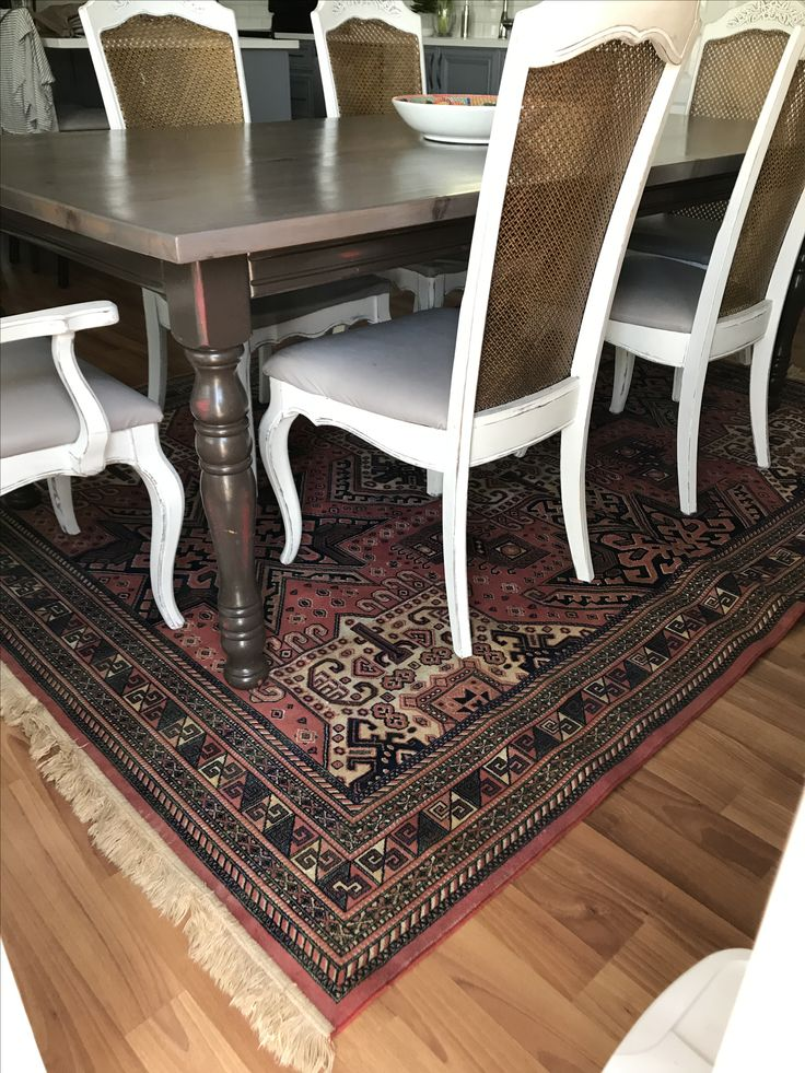 Farmhouse table refinished chairs antique tapestry rug
