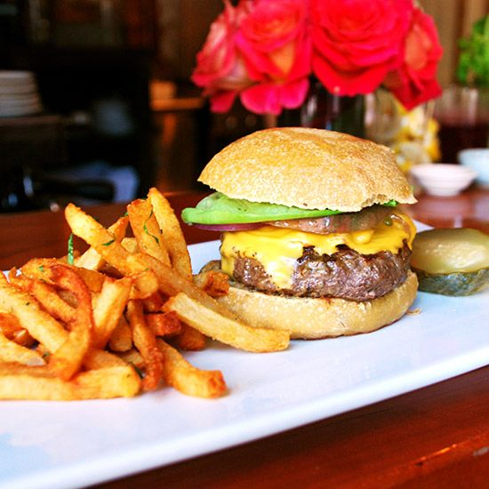 Bacon Cheeseburger. Chef Joey Campanaro gets his beef from famed Manhattan purveyor Pat LaFrieda and serves each burger on a house-baked bun, with just a hint of molasses. Pickles from legendary purveyor Guss' Pickles are served on the side. #yummy #food #burger