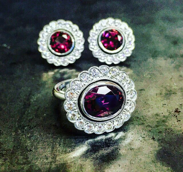 Handmade rhodolite, fine diamonds and white gold with a classic design inspiration.