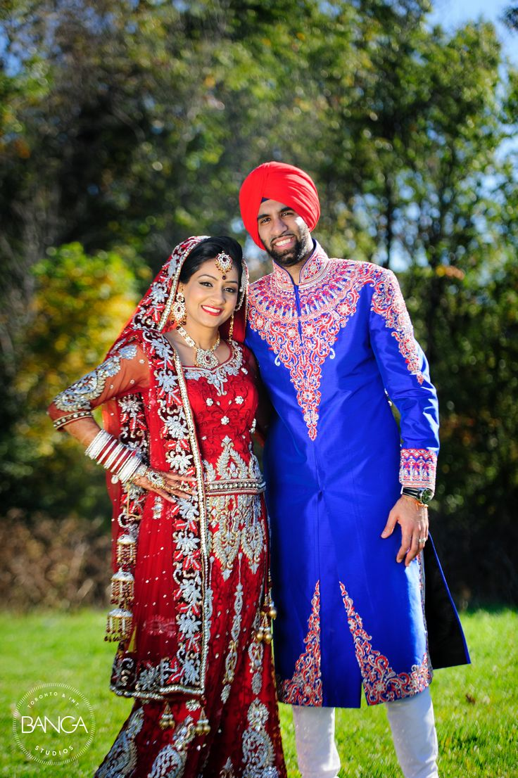 bride: red lengha with silver accents groom: royal blue sherwani with ...