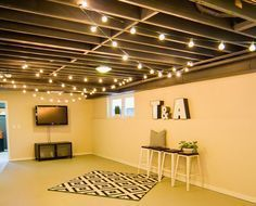Have basement ceiling painted, then add lights. Could do half pained walls to heighten. Also ceiling to floor curtains to heighten.