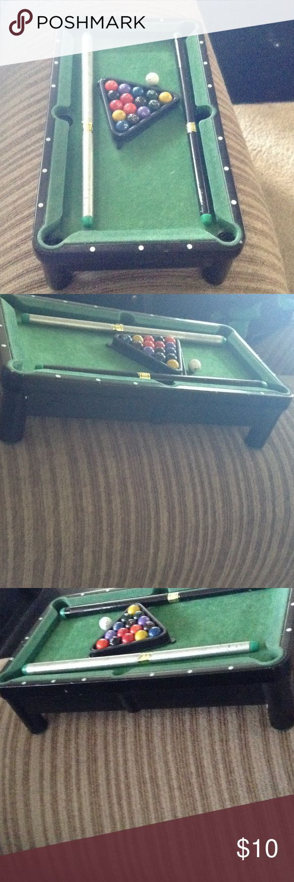 Mini tabletop Remote not included. Using for size comparison. Used tabletop pool table. Some scuffs and scratches on balls and around table and on sticks. Other