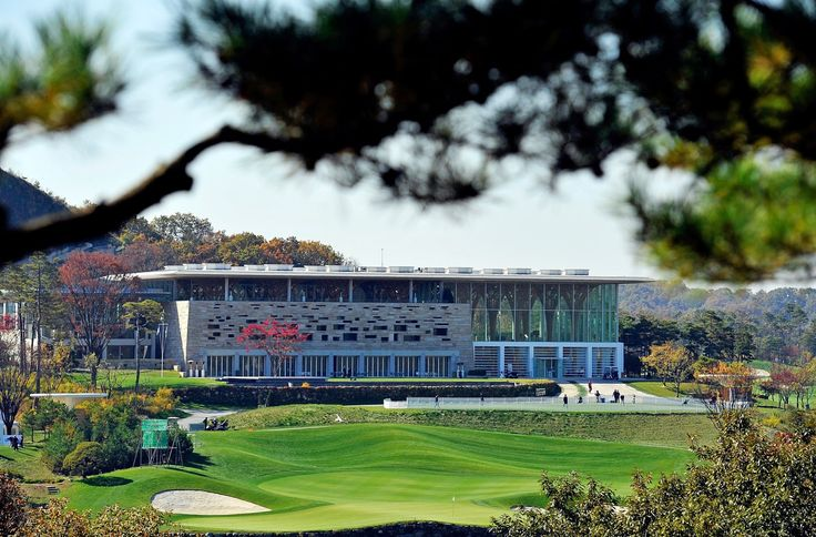 Located two hours outside Seoul, South Korea, the Haesley Nine Bridges Golf Clubhouse features a distinctive glass atrium with treelike timber columns that seamlessly integrate with the ceiling's hexagonal wood grid. Completed in 2009, the clubhouse features separate spaces for regular members and VIPs.
