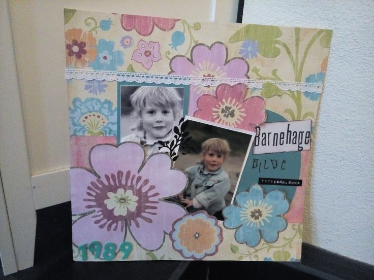 Layout that I made , when I went to kindergarten . I 've cut a pattern sheet with flowers , cut around the flowers and placed it on top of another sheet . Photo placed slightly below the flowers . The images are the same, black / white and color