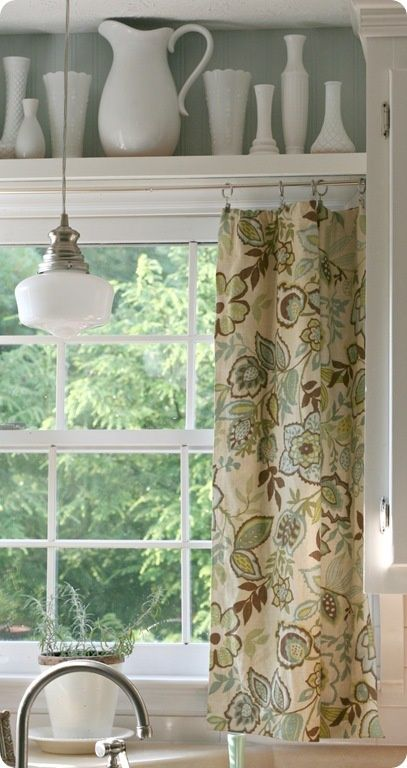 Kitchen Window Treatment:  Shelf between cabinets with display items, curtain hung beneath.  Love the pattern on the curtain.