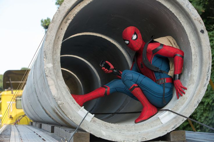 Look out! Here comes the Spider-Man! Marvel & Sony have debuted two new photos from the upcoming Jon Watts-directed film, featuring Tom Holland fully suited up in the good ol' red and blue!