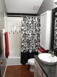 black and white bathroom decor with hints of red to coordinate with the red carpet in my master bedroom.