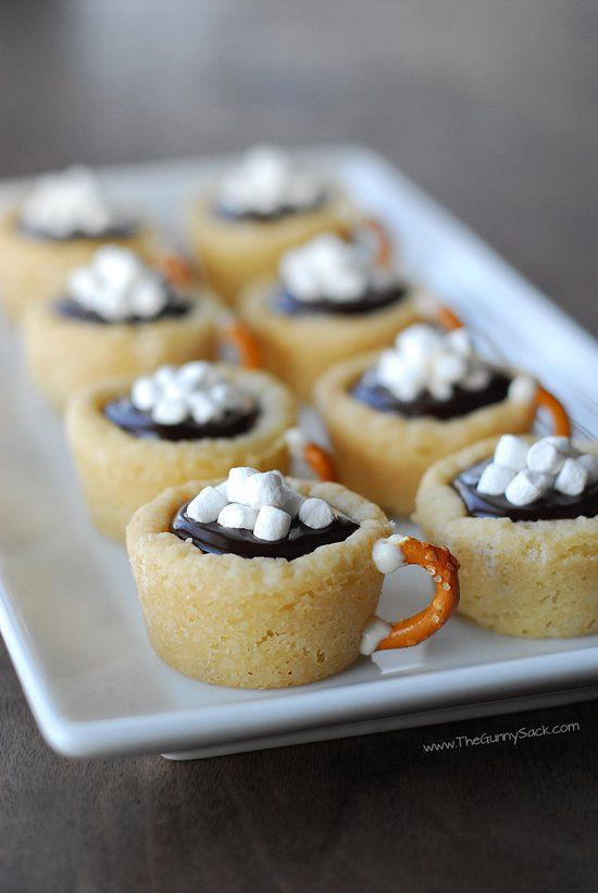 This easy cookie recipe for Hot Chocolate Cookie Cups is made with Pillsbury Sugar Cookie dough. They're filled with chocolate ganache and have a pretzel handle!