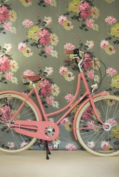 vintage wallpaper and a vintage pink bike together