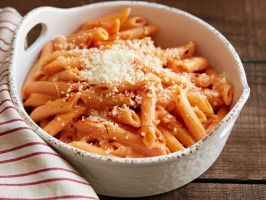 Penne alla Vodka : Ree brings Italian comfort food to the range with this rich and decadent pasta dish, made with tomato sauce, vodka, heavy cream and a pinch of red pepper flakes for subtle spice.