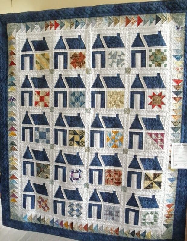 love schoolhouse quilts-no info but very cool use of sampler blocks and look at the boarder with two colors