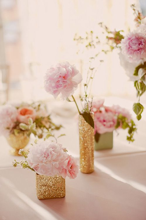 Soft pink peonies in gold glitter vases