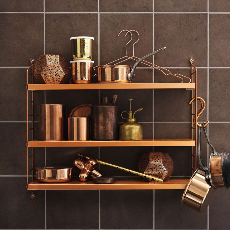 Designed in 1949 by Swedish architect Nils Strinning, Copper String Pocket is a shelving system which lends itself to large and small compositions.