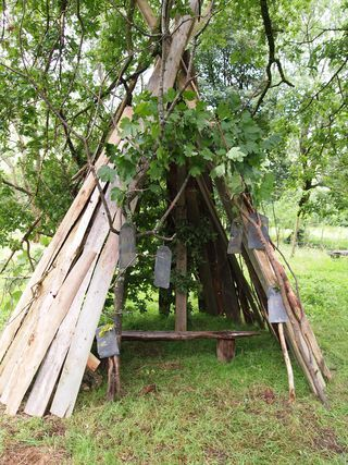 slates hung on string outside a den...an invitation to write! #abcdoes #markmaking #markmakingoutdoors