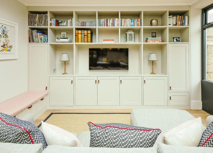 Playroom room. Fermoie banquette seating. Christopher Farr fabric on cushions. Bespoke joinery.  Rosi du Ruig lamps. Little Greene Paint. Talia Cobbold Interior Design.