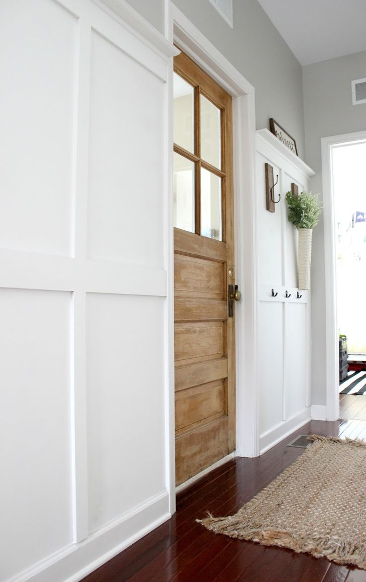Add instant charm and character by replacing a standard laundry room door with a beautiful, old vintage door.