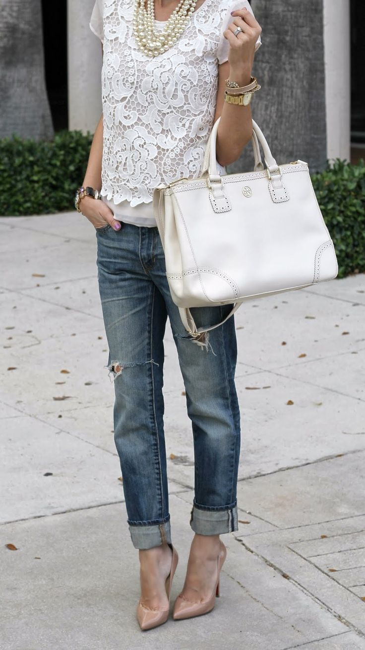 Try pairing a white lace short sleeve blouse with navy destroyed boyfriend jeans to create a chic, glamorous look. Elevate your getup with nude leather pumps.   Shop this look on Lookastic: https://lookastic.com/women/looks/short-sleeve-blouse-boyfriend-jeans-pumps-tote-bag-pearl-necklace-bracelet-watch/12452   — Beige Pearl Necklace  — Beige Bracelet  — Gold Watch  — White Lace Short Sleeve Blouse  — White Leather Tote Bag  — Navy Ripped Boyfriend Jeans  — Beige Leather Pumps