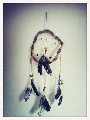 Salt & Pepper Feather Hand made South American dream catcher. Keeps the bad dreams at the door.