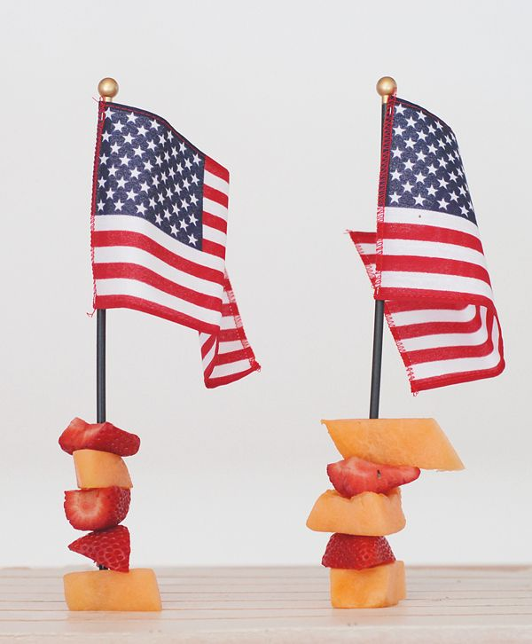 Use the sticks of small flags as kabob skewers. Fill with fruit and stand at attention for easy 4th of July party decor.