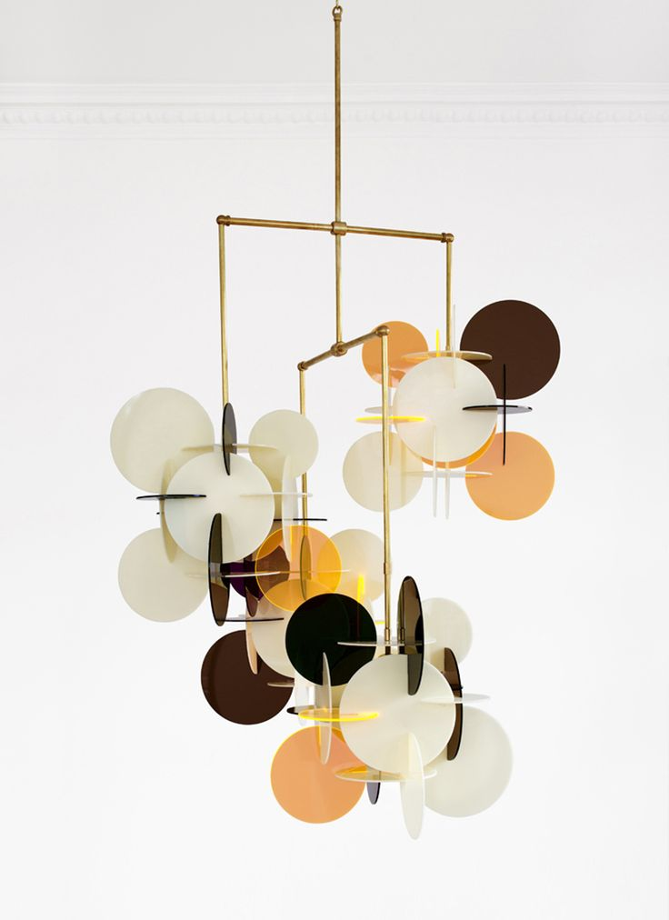 This fun chandelier is the kind of centre piece that can transform a room from drab to glam. It's a design in plexiglas and brass, called Diciotto x 4 by Vibeke Fonnesberg Schmidt for Milan gallery Nilufar.