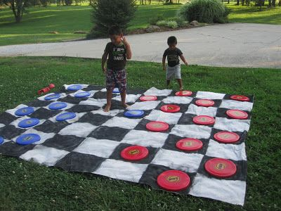 diy giant backyard checkers | found these perfect sized frisbees at the dollar store and picked up ...