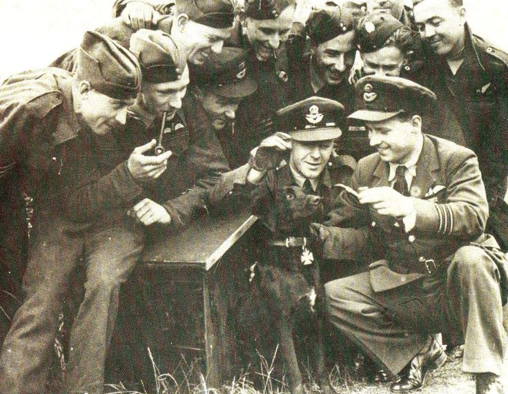 Guy Gibson on the right holding a pipe and with his dog at RAF Scrampton - - RAF - Dambusters